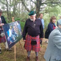 J. Peter McIllwain Clan association President with a piece of the tartan that went to the moon.